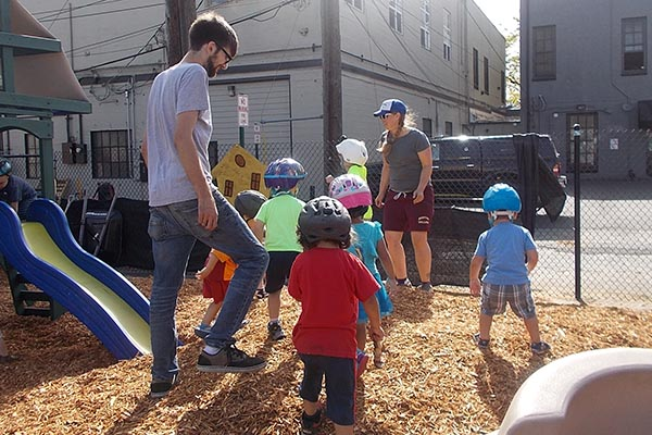 teachers and toddlers in preschool playground